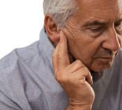 senior man suffering from tinnitus in right ear